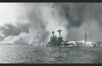 Here, a battleship is sinking after being bombed by Japanese aircrafts.