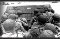 D-3) U.S. soldiers head toward the beach in an LCVP. US Army Signal Corps