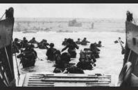 D-4) U.S. soldiers wade to shore through Nazi gun and mortar fire. US Coast Guard