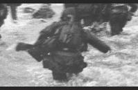 E-1) Robert Capa, photographer for Life magazine, went ashore at Omaha Beach with Company E, 16th Regiment, 1st Infantry Division