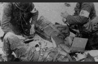 E-3) U.S. medics tend to the wounded on Utah Beach. US Army Signal Corps