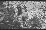 A-5) Barbed wire on a Normandy beach. US Army