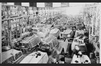 B-2) A Higgins Industries factory producing LCVPs. Eisenhower Center